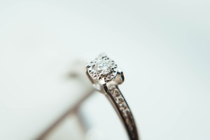 silver-colored clear gemstone ring