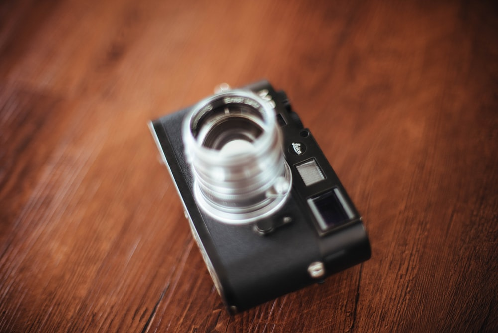 black camera on wooden surface