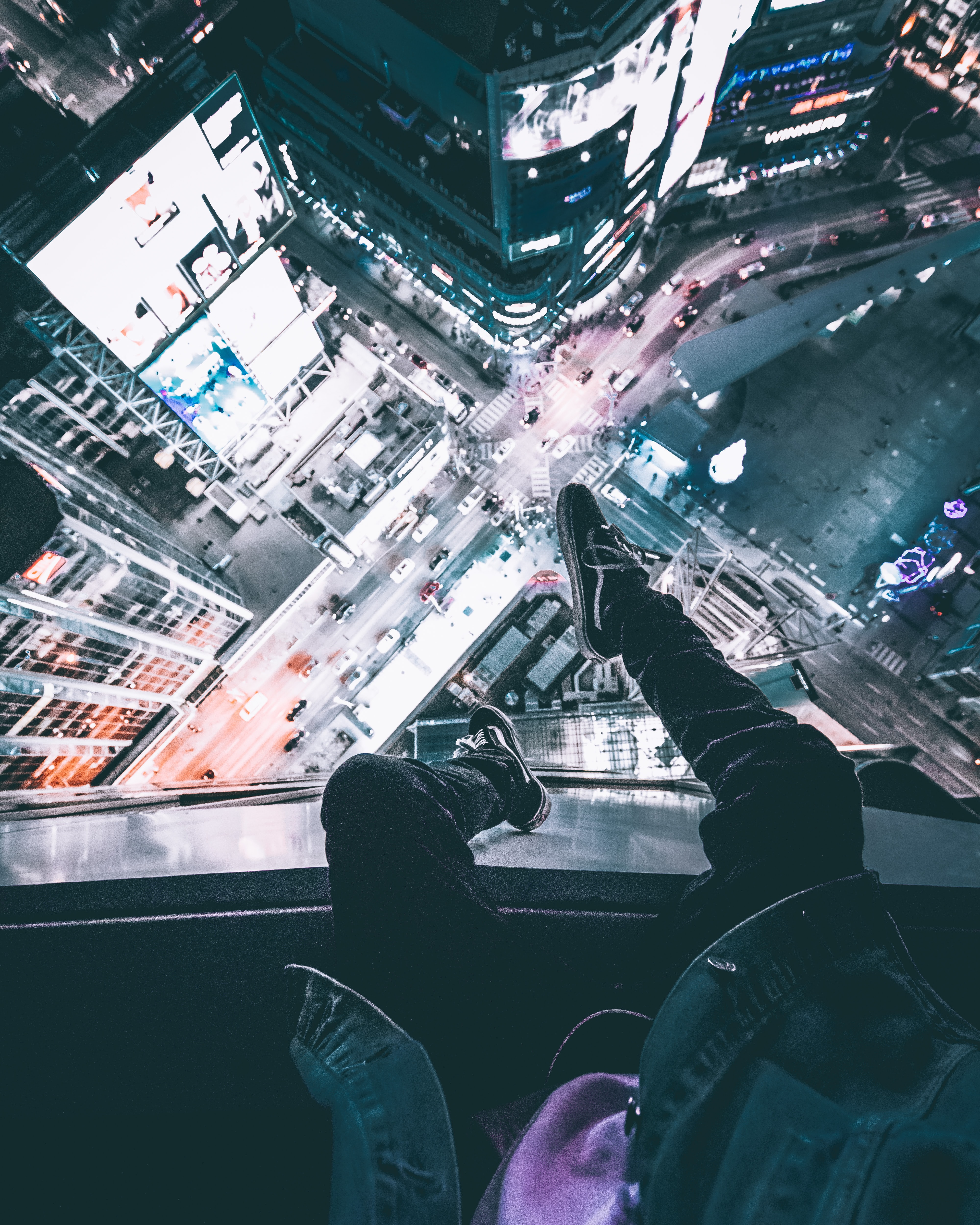 person sitting on top of the building during nighttime