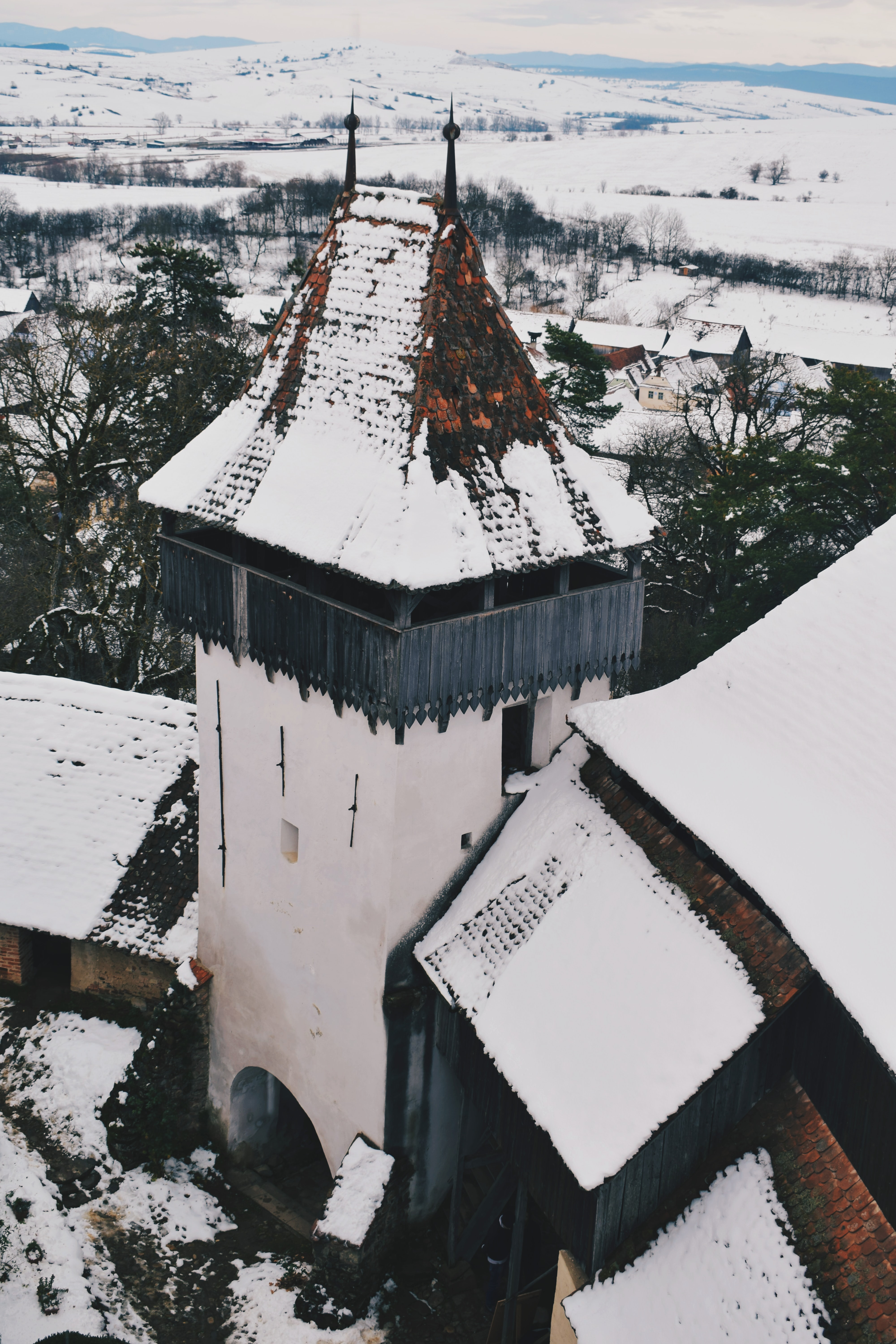 aerial photography of white and black concrete tower during winter
