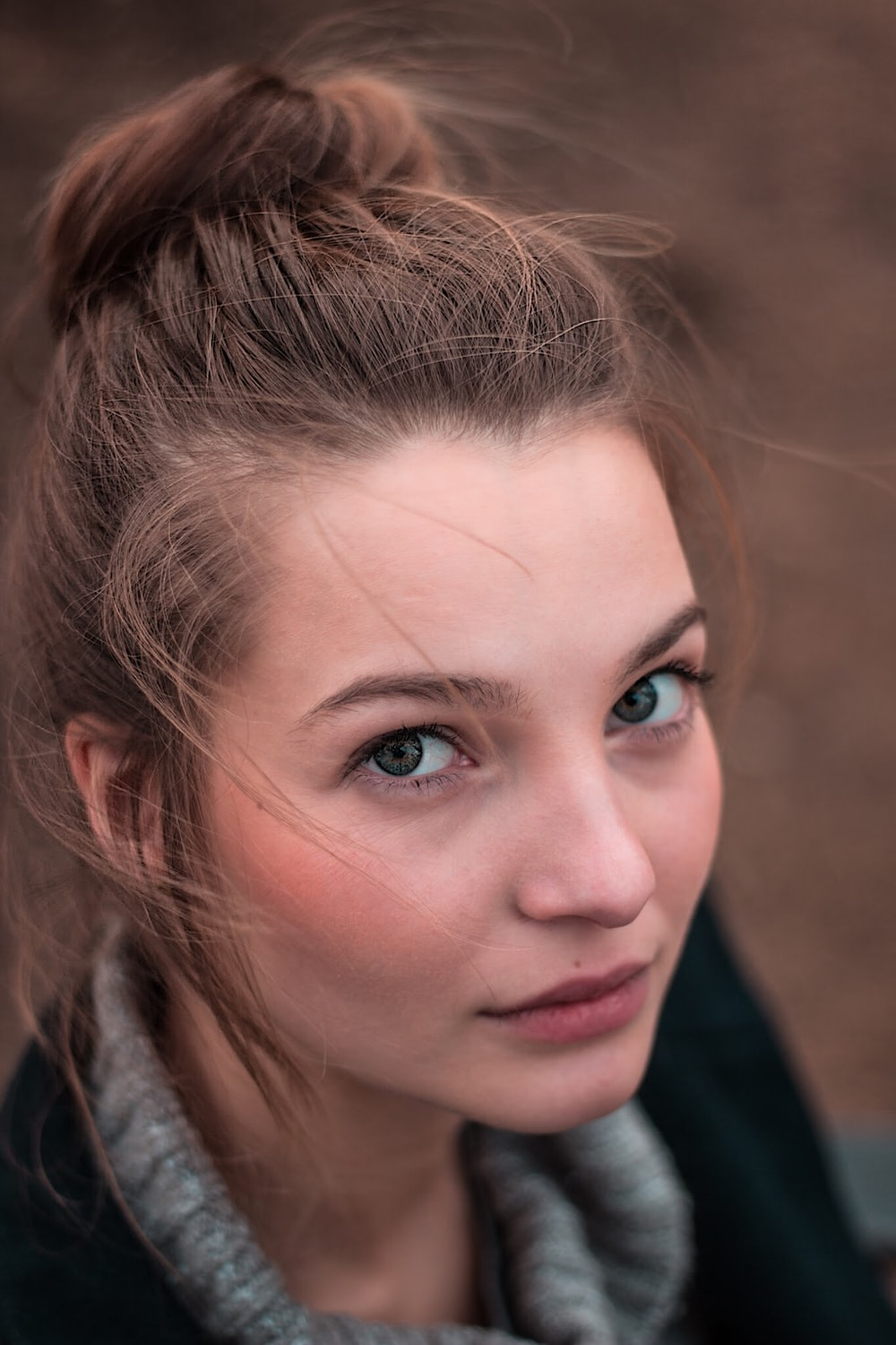 shallow focus photo of woman face
