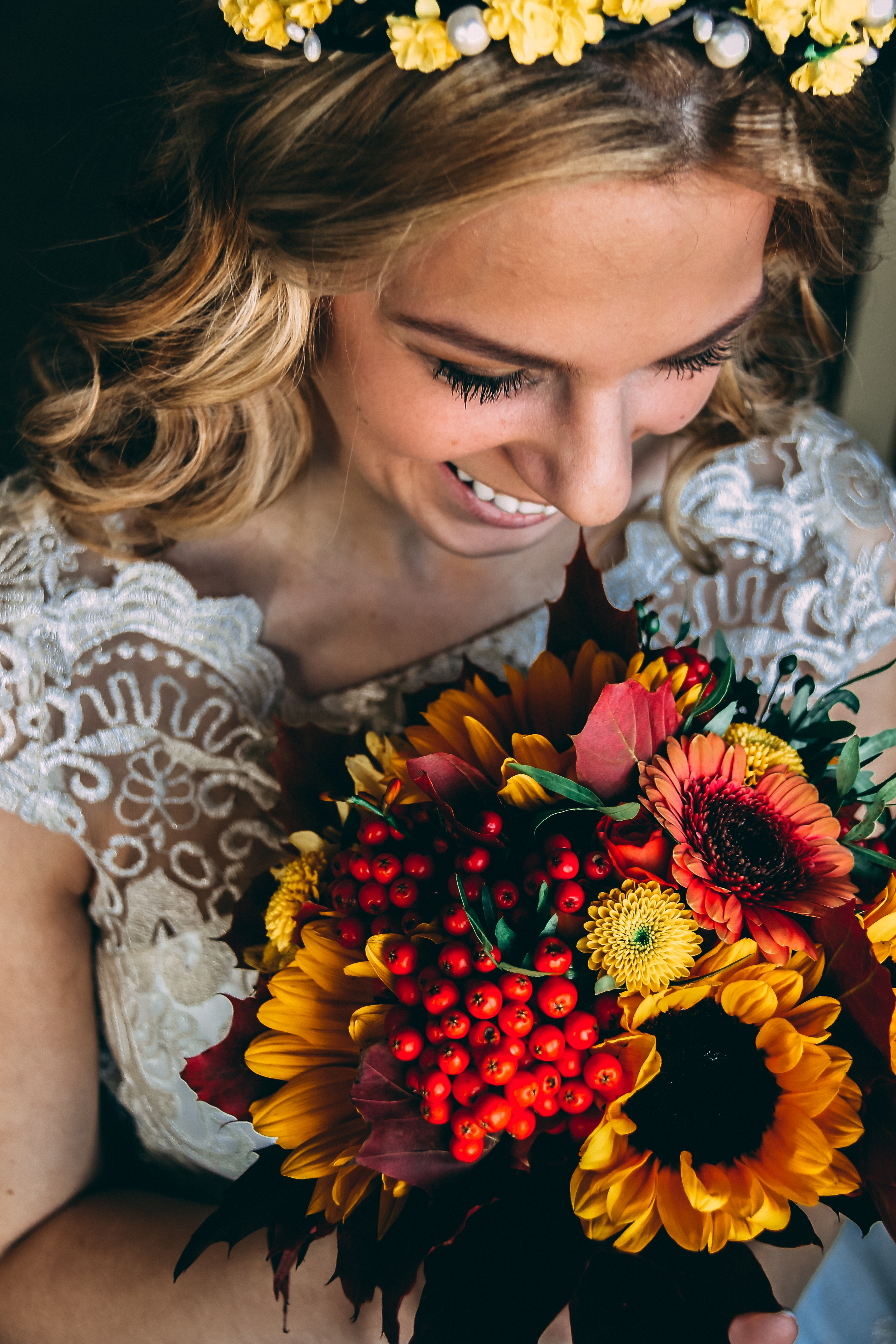 smiling woman holding bouquet of flowers