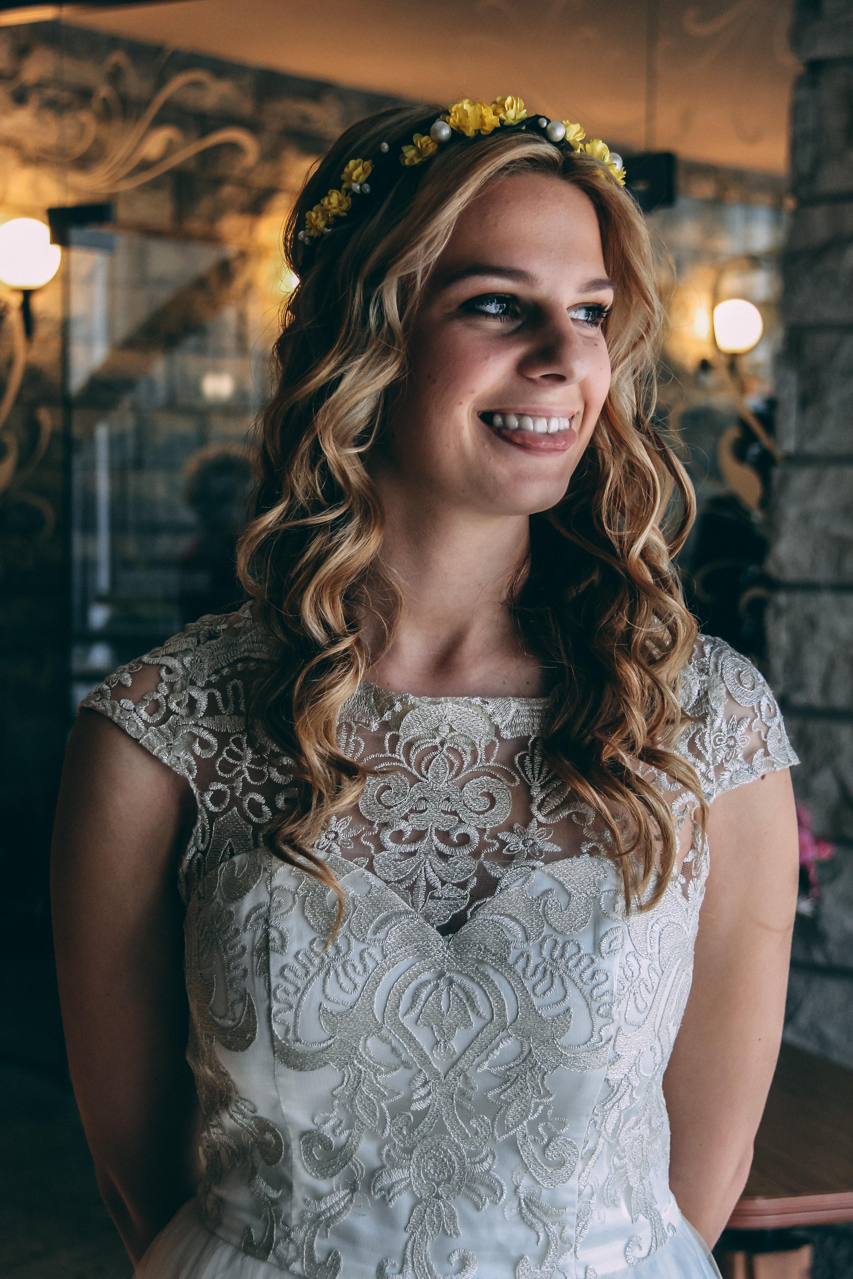 woman smiling while taking photo