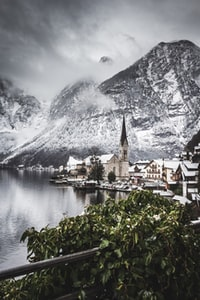 town on the foot of a snow capped mountain