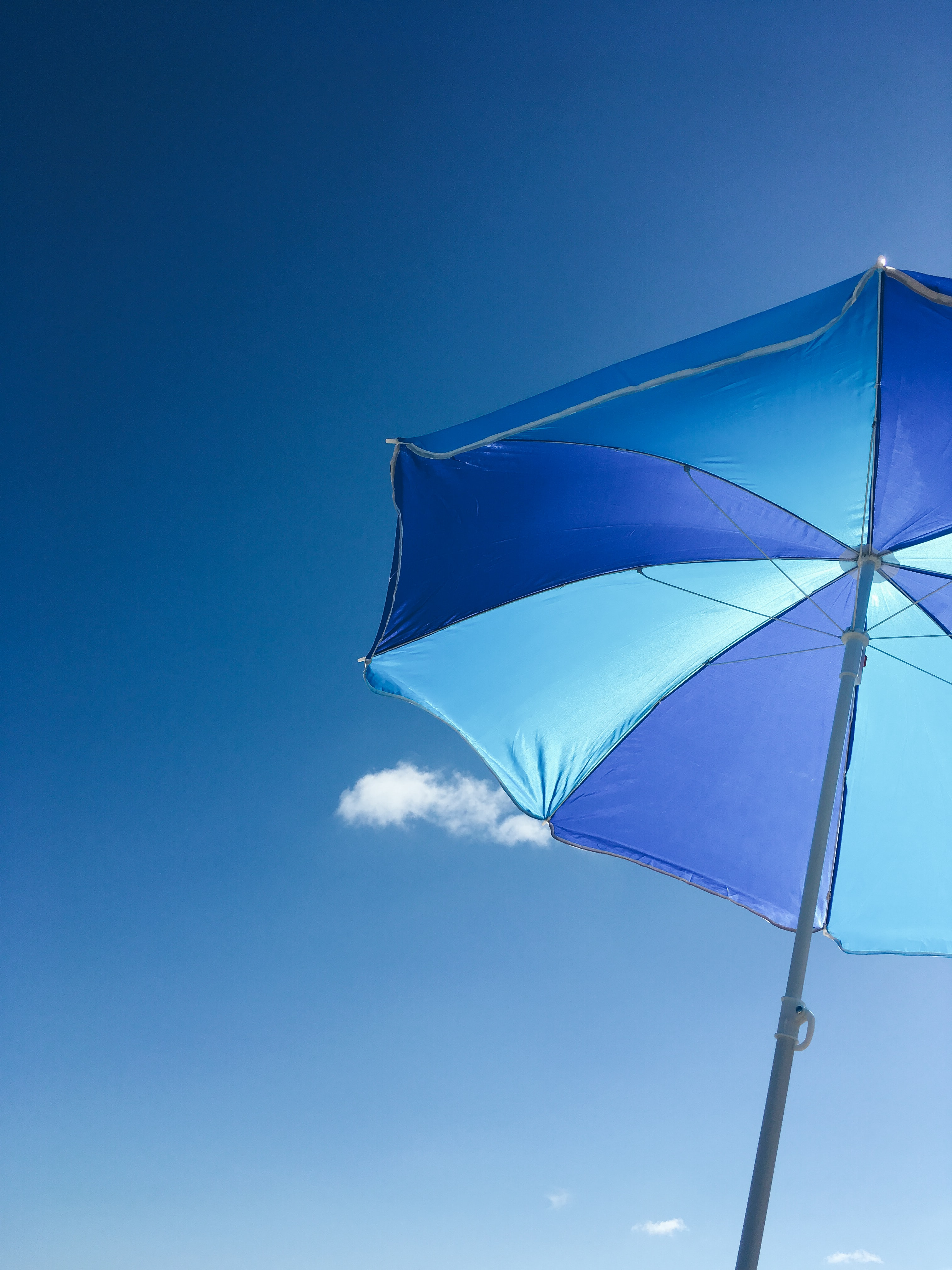 worms-eye-view of blue patio umbrella