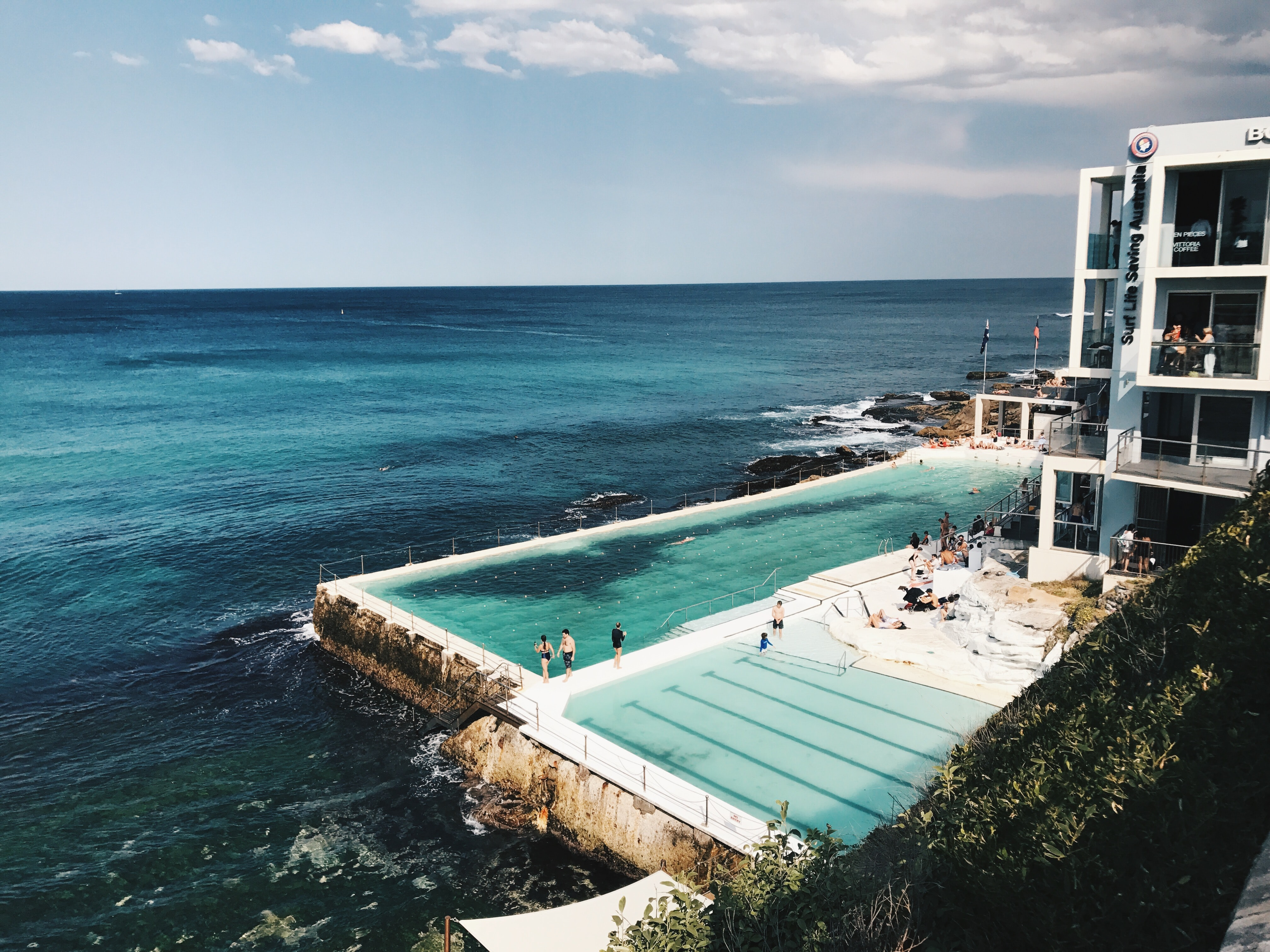 large swimming pool near ocean in landscape photography