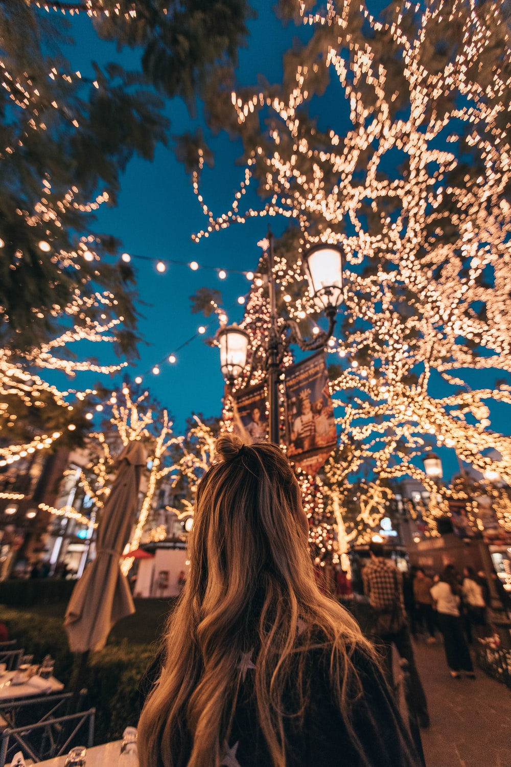 woman seeing string lights