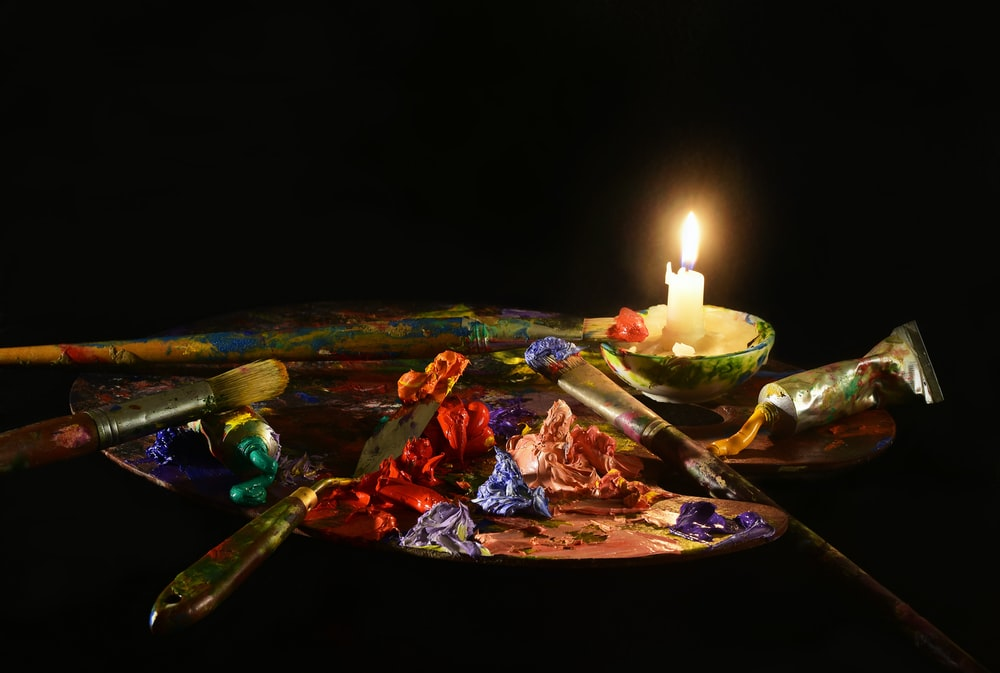 paint palette with candle