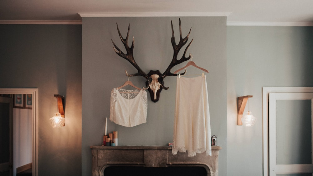 white textile hanging on wall