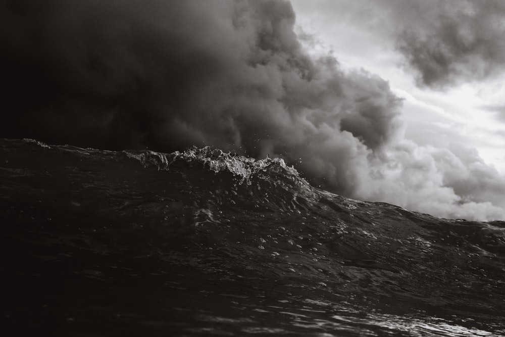 grayscale photo of beach waves