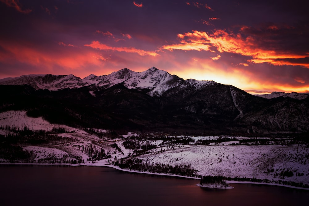snow-covered mountain during golden hour