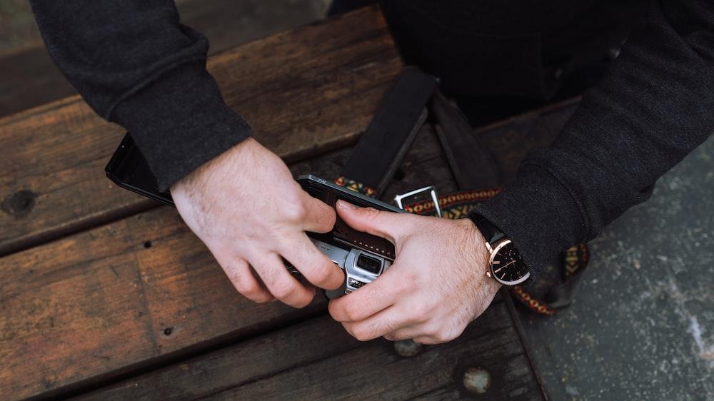 person holding film camera