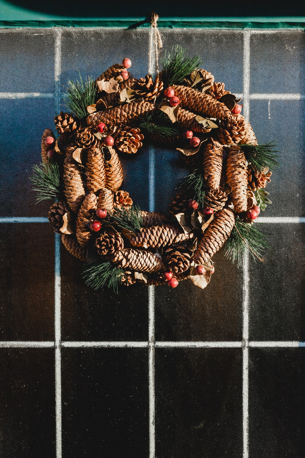 hanging green, red, and green wreath