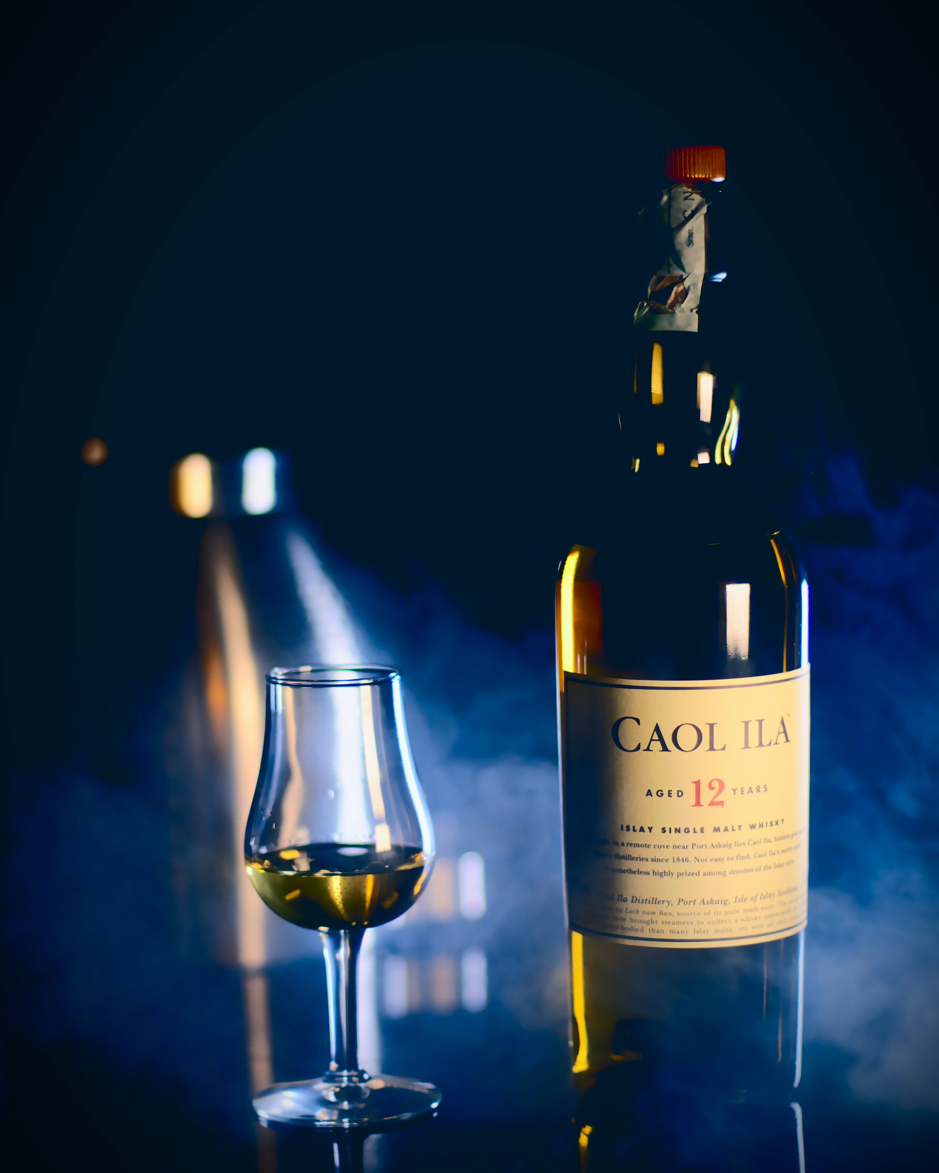 Caol Ila bottle near wine glass