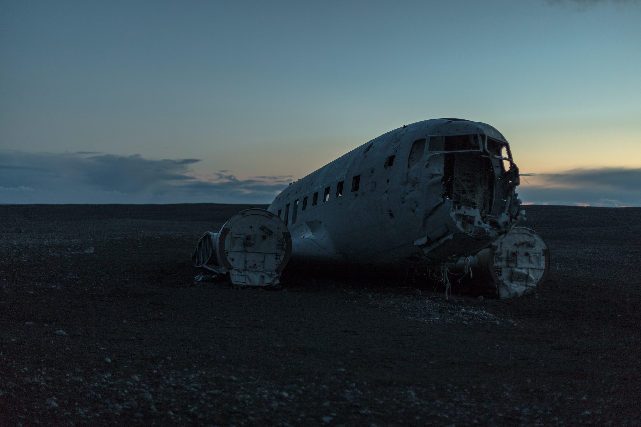 photo of abandoned plane on soil