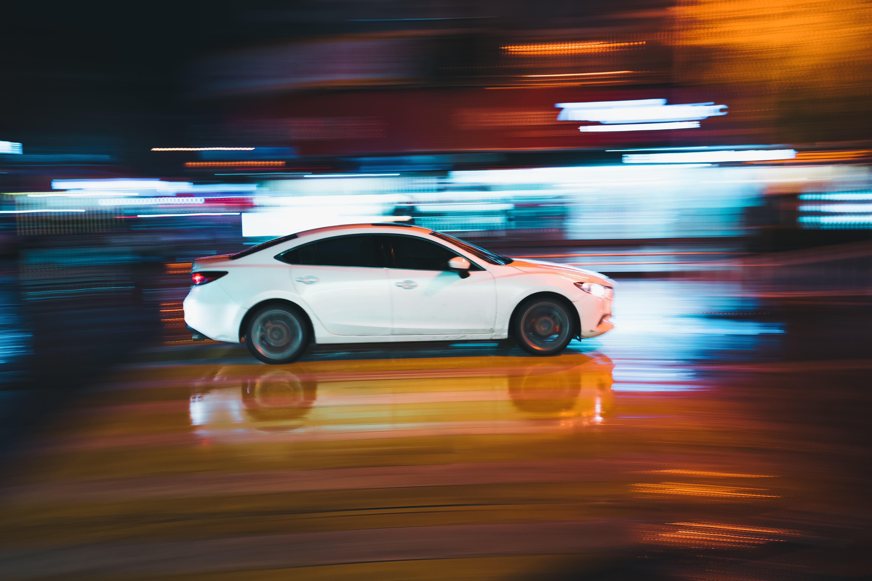 timelapse photography of white sedan