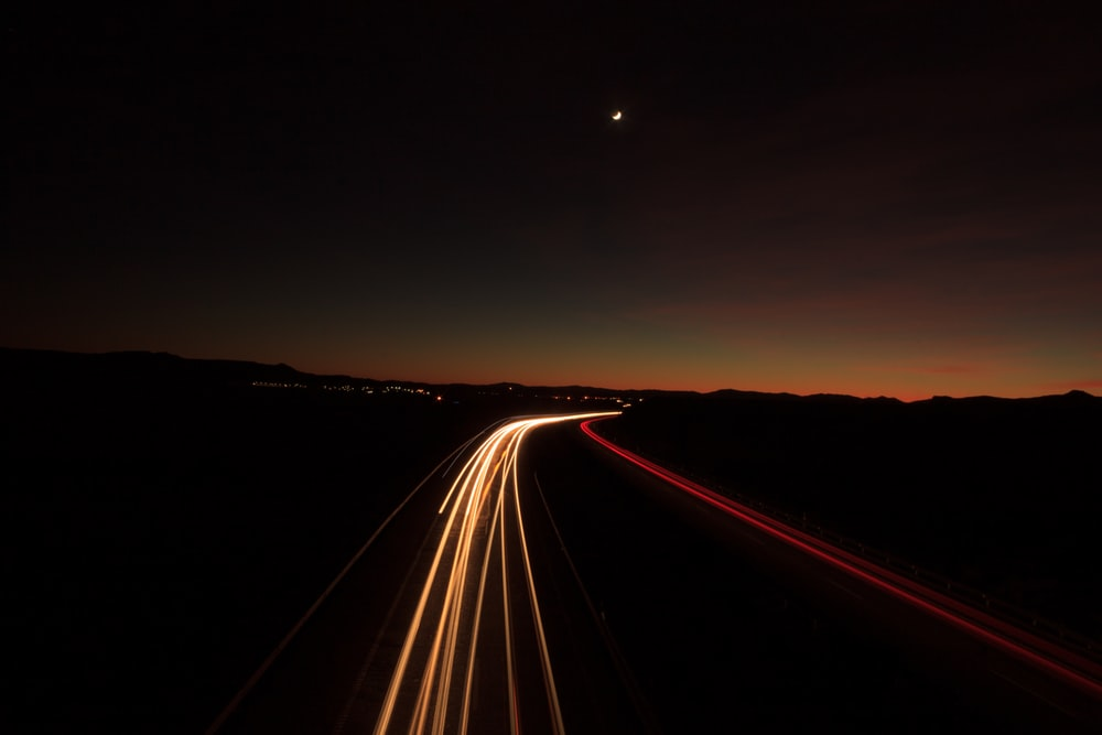 time lapse photography of highway at night