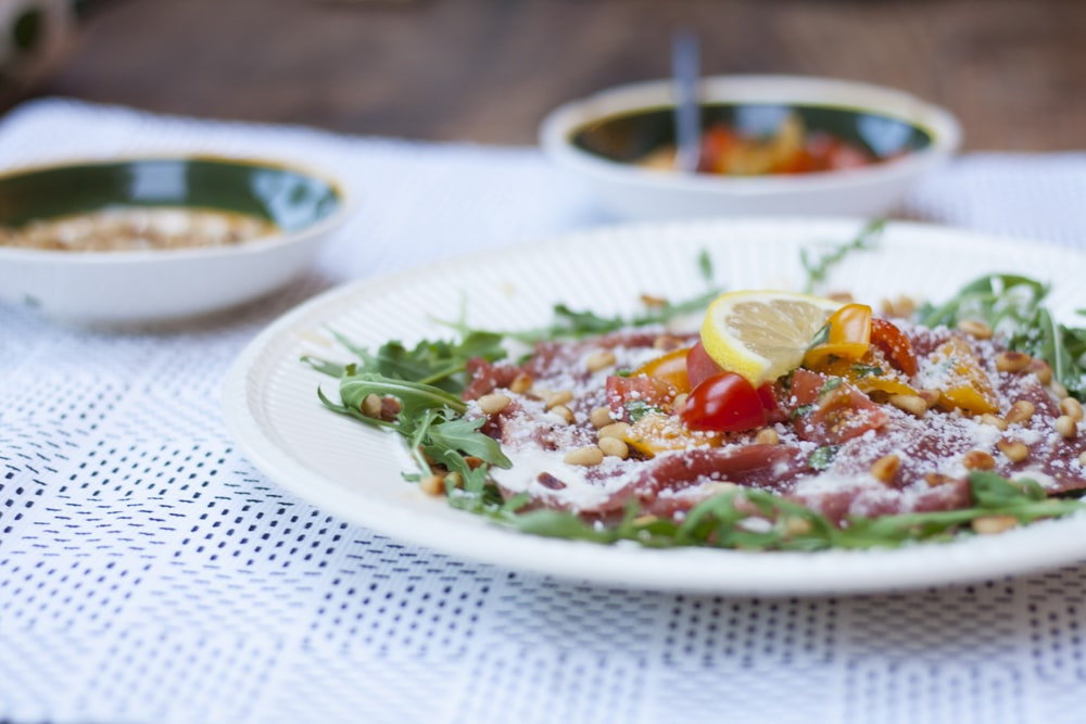 vegetable salad served on white ceramic plate