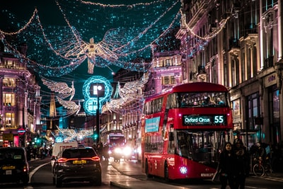 photo of bus passing on city with lights london zoom background
