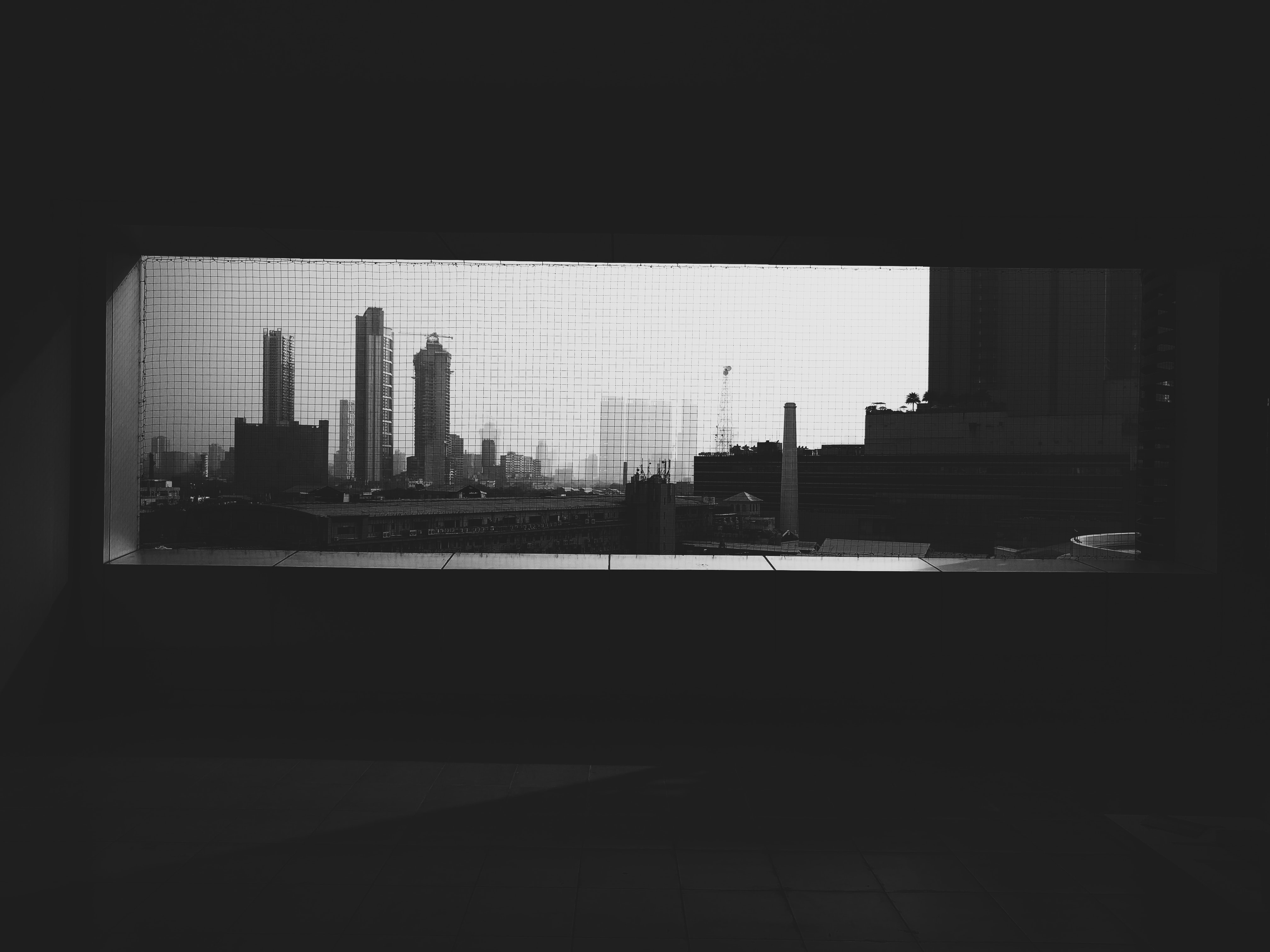 grayscale photo of highrise city buildings
