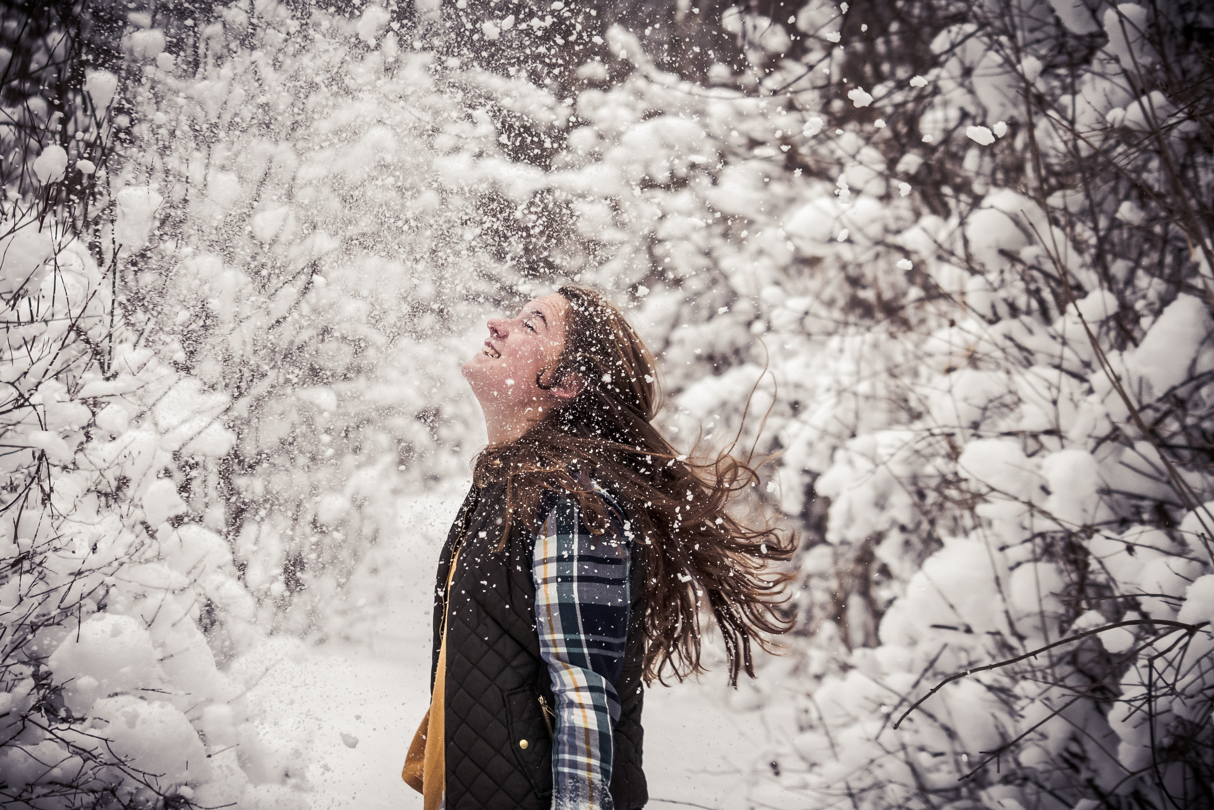 girl leaning up on the snow field