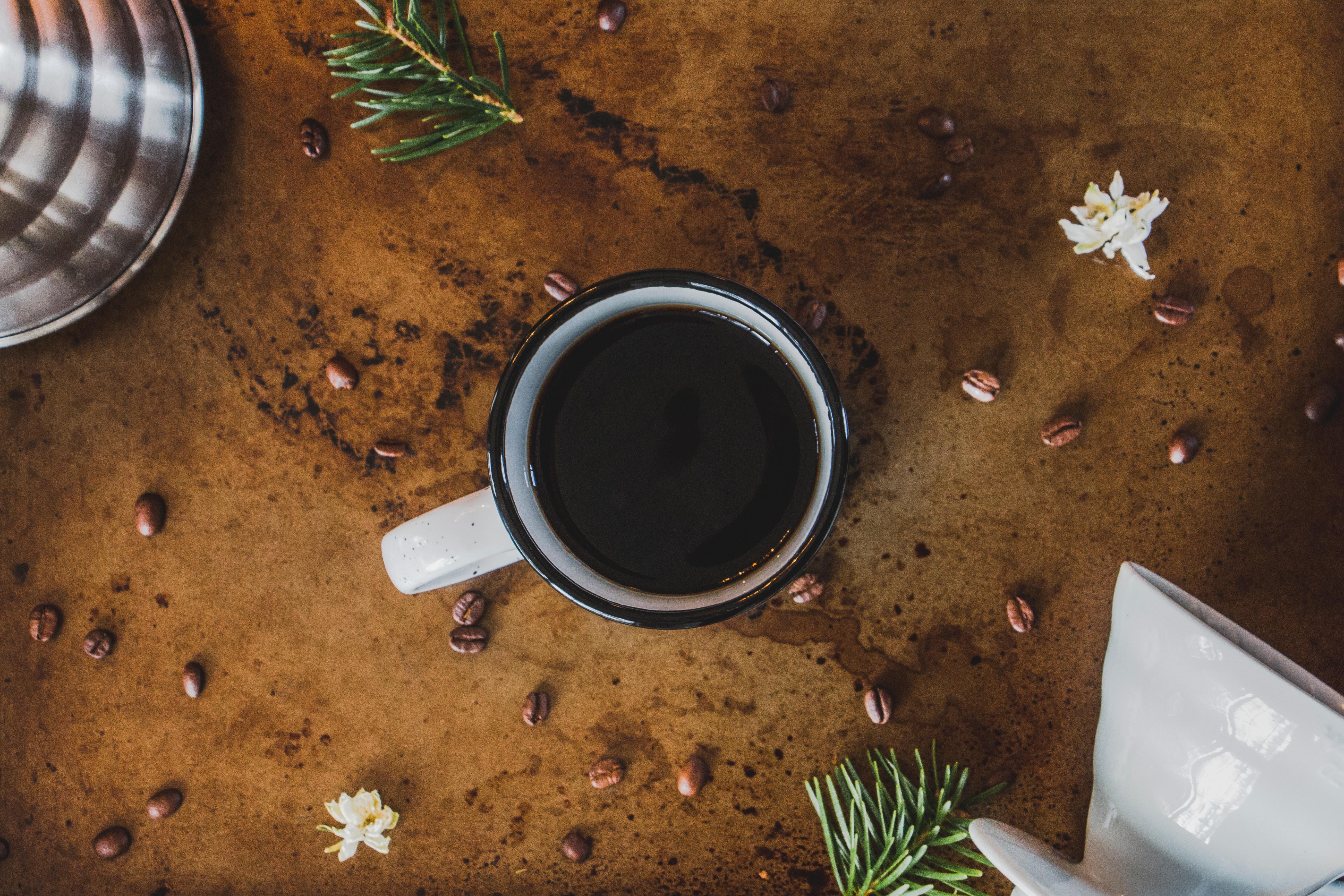 black liquid in white and black ceramic mug