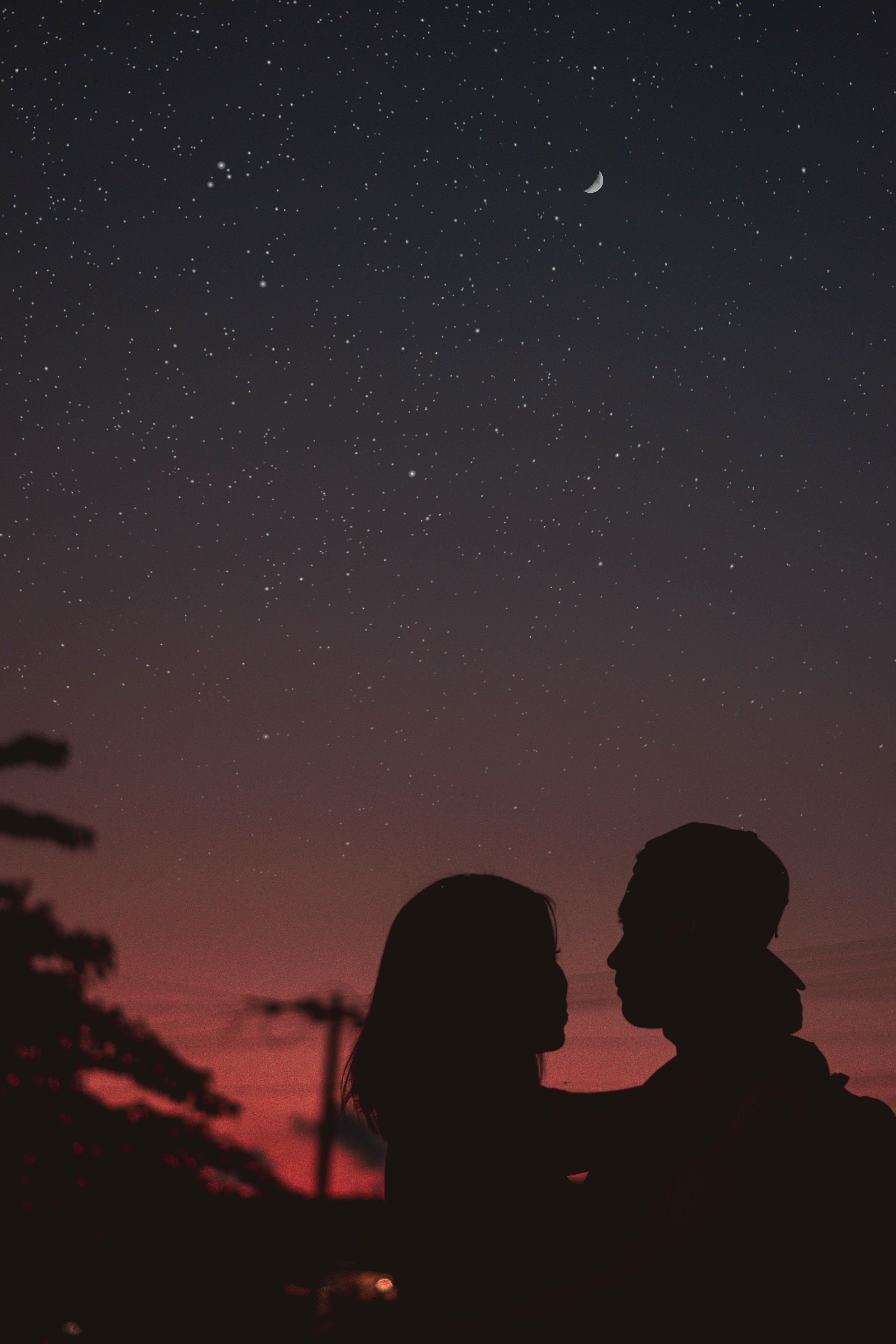 silhouette of woman hugging mna under starry night sky