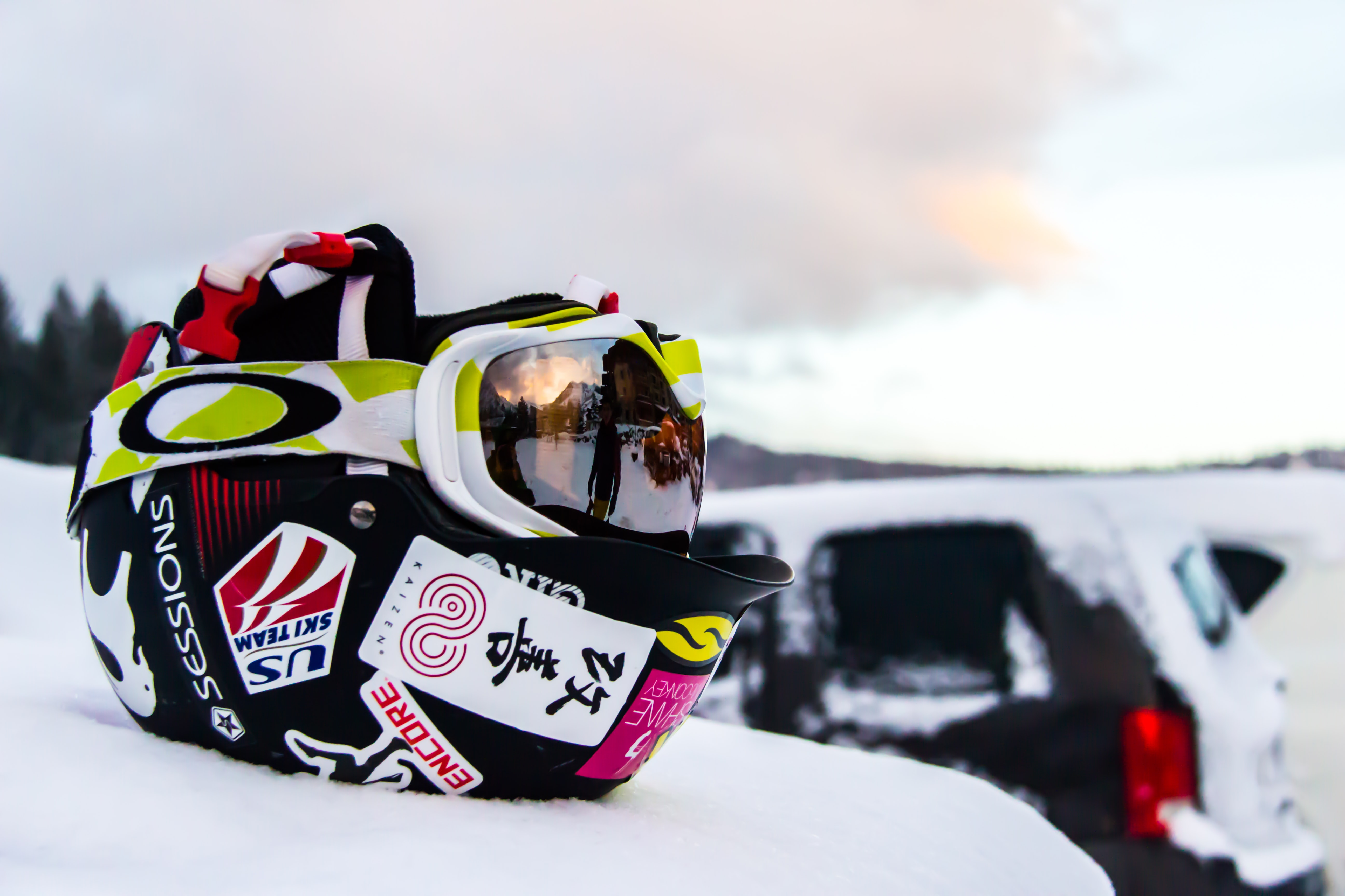 black and multicolored helmet on snow