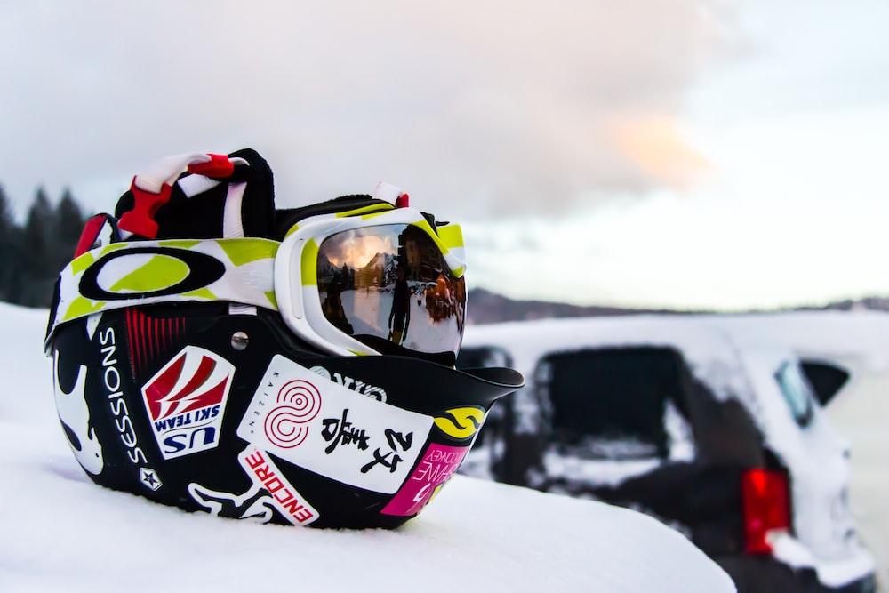 black and multicolored helmet on snow
