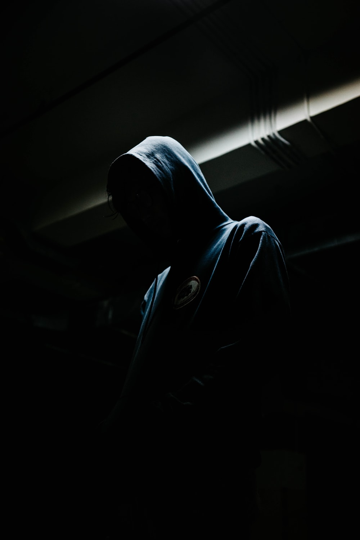 person in black hoodie