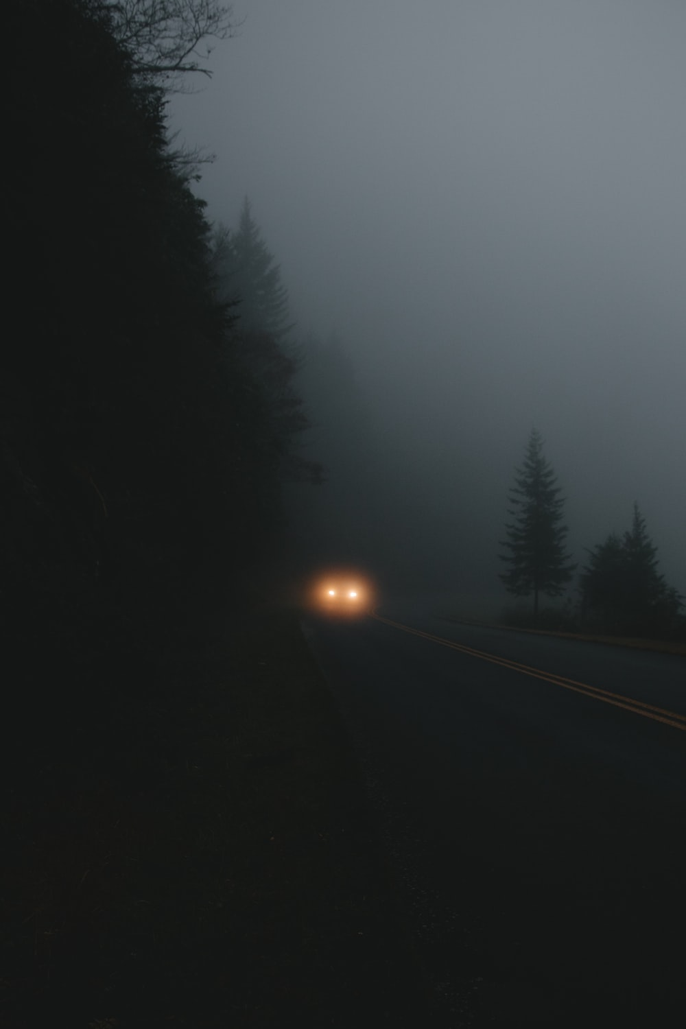 vehicle on road during nighttime