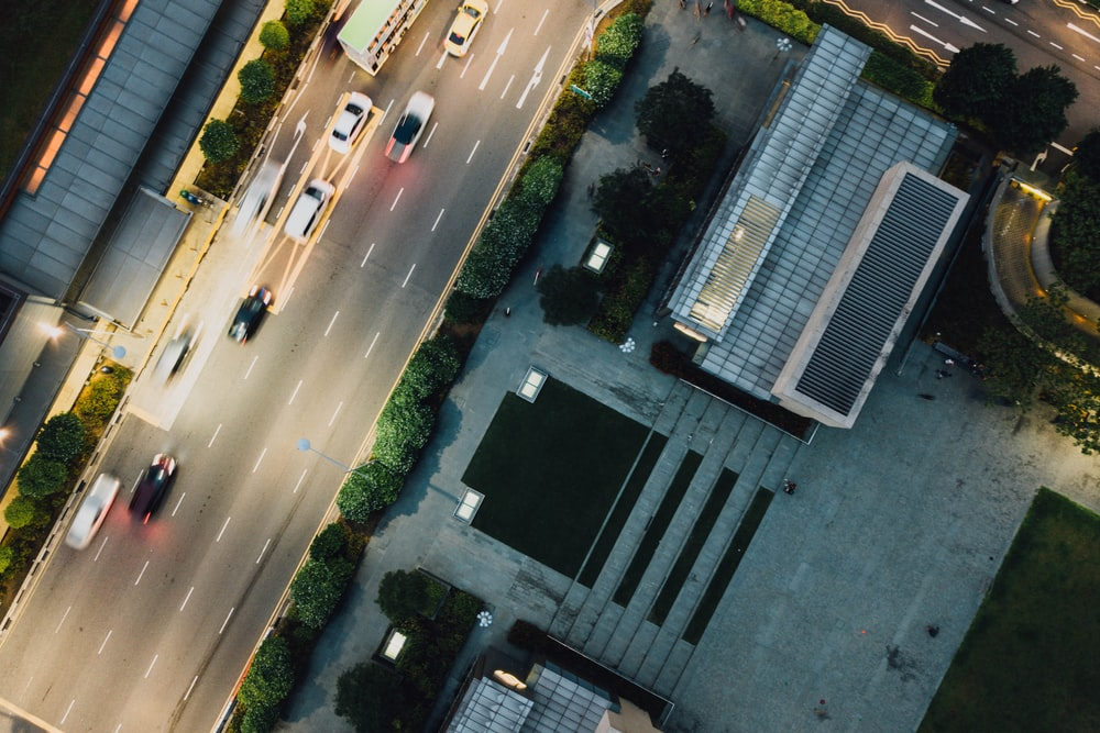aerial photography of cars driving on road