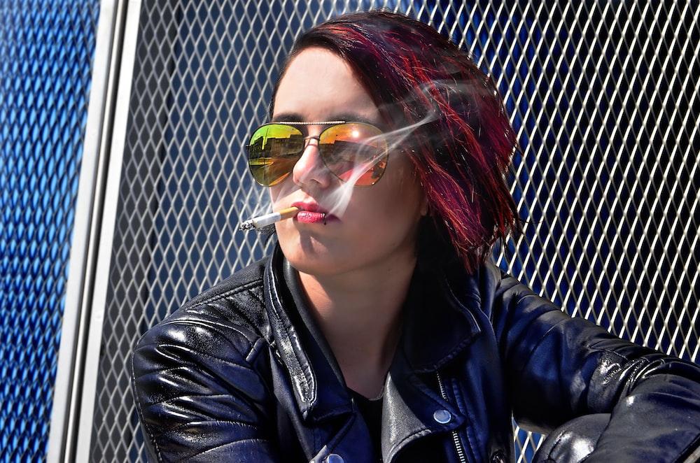 woman sitting while smoking