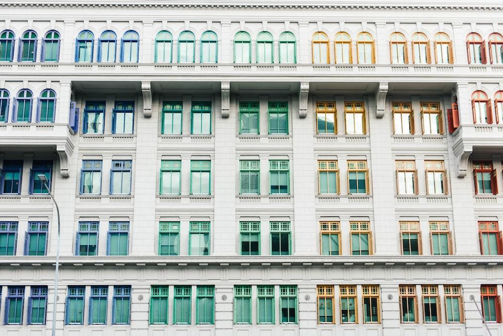 white concrete building with glass windows