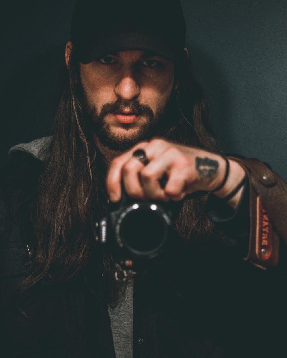 man holding DSLR camera