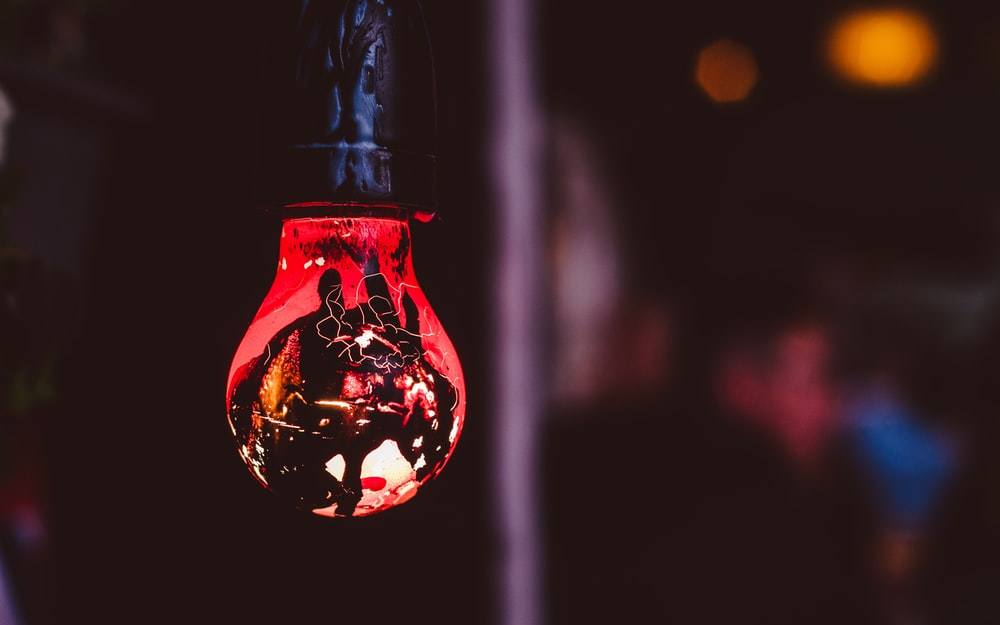 hanged red and black light bulb