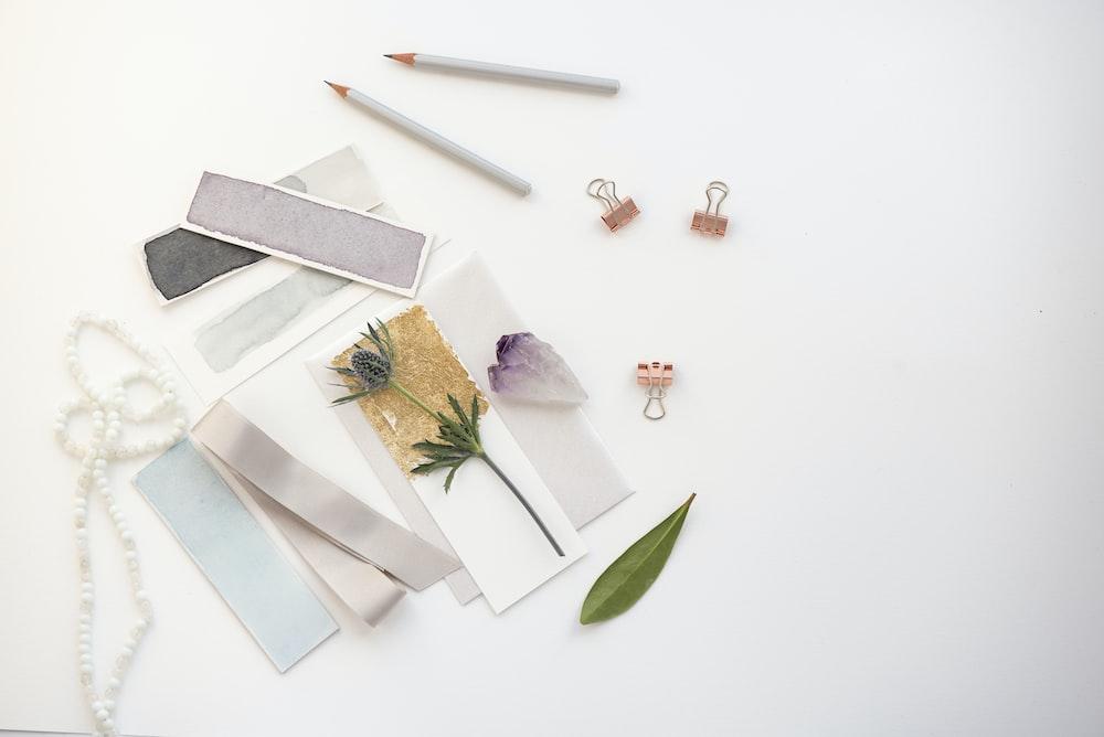 flowers on card near pencil