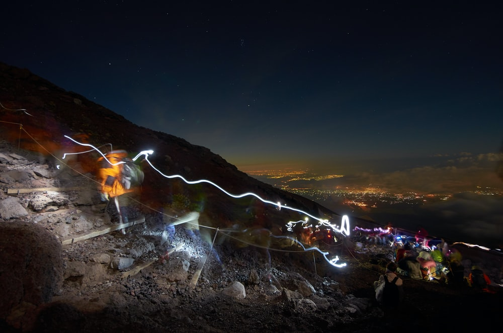 assorted-color lights on mountain at nightime