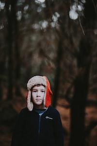 boy wearing red ear pluff