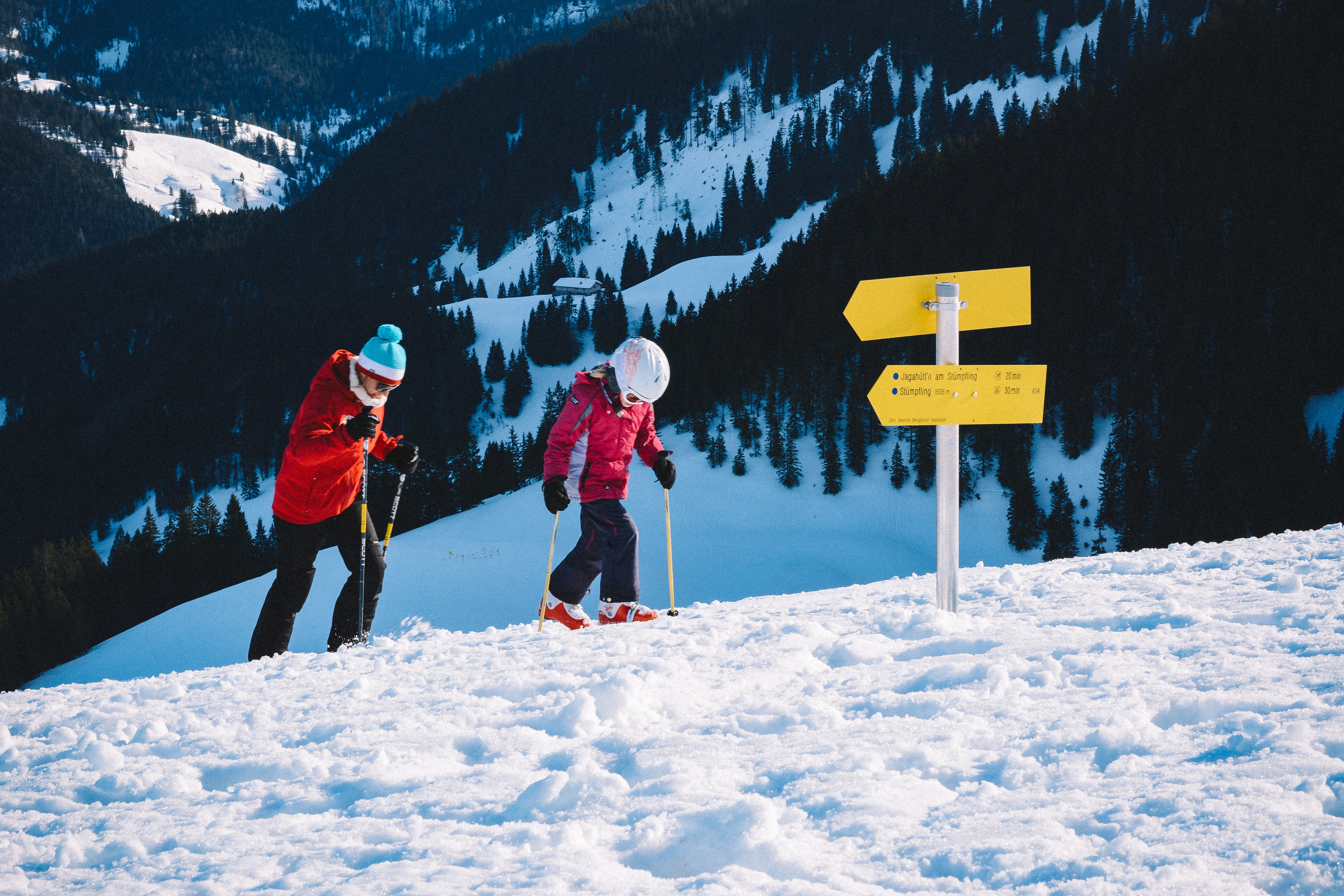two person playing snow skis
