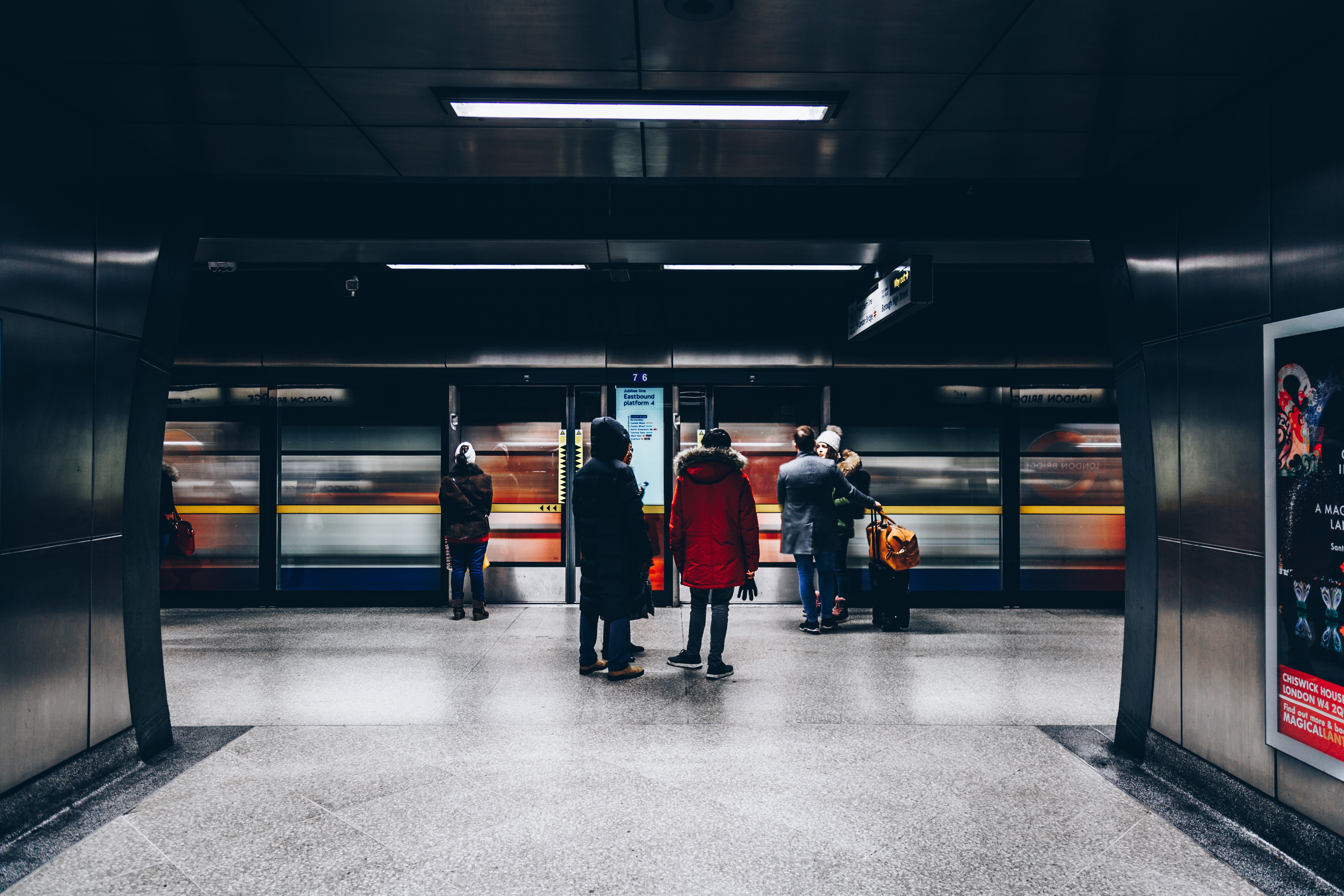 people waiting for train in station