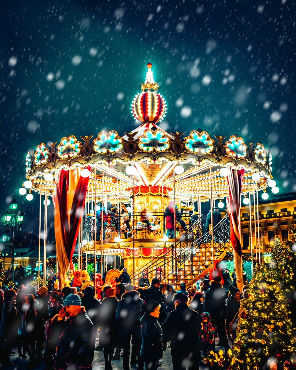 carousel with snow pouring down
