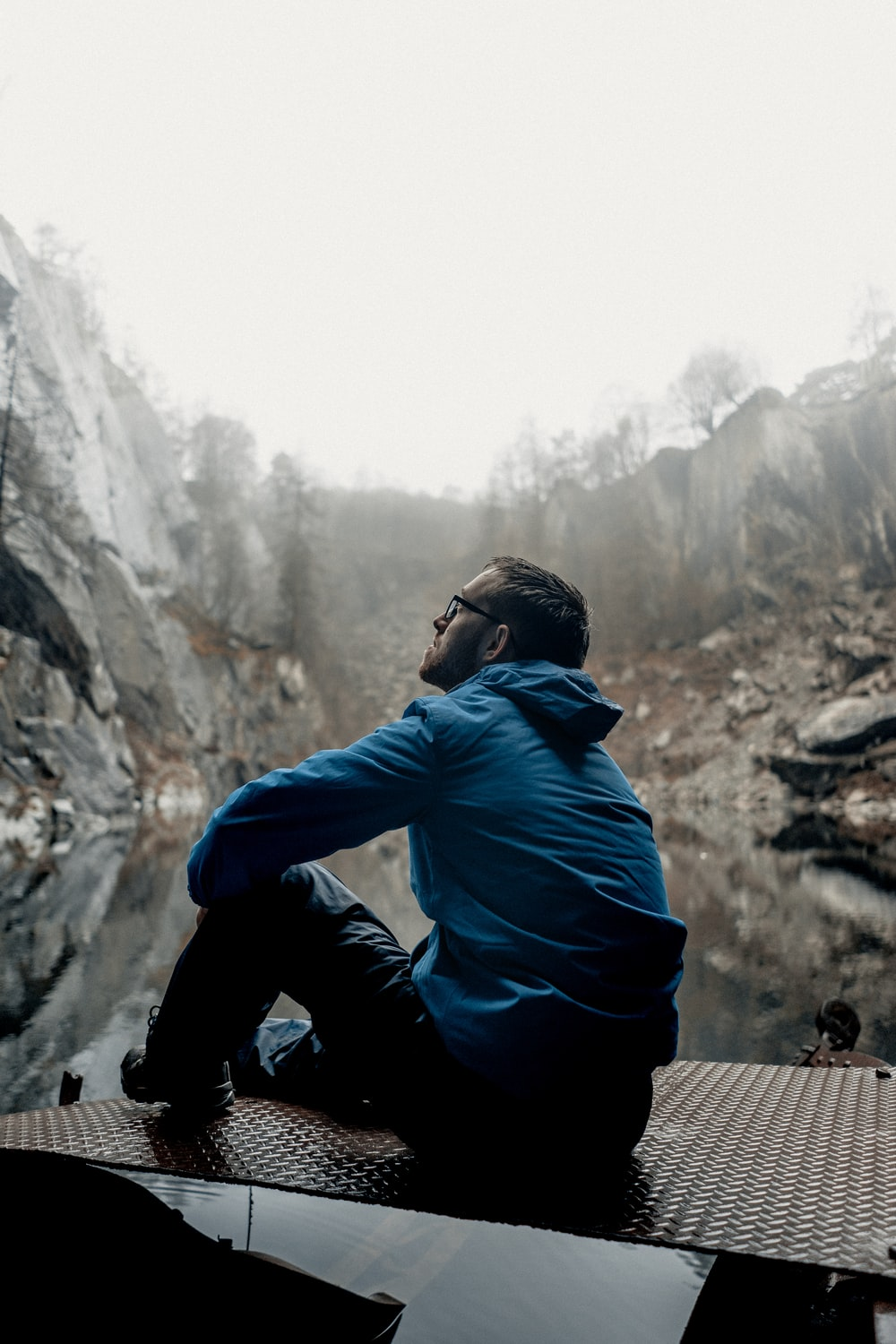 man sitting while looking up