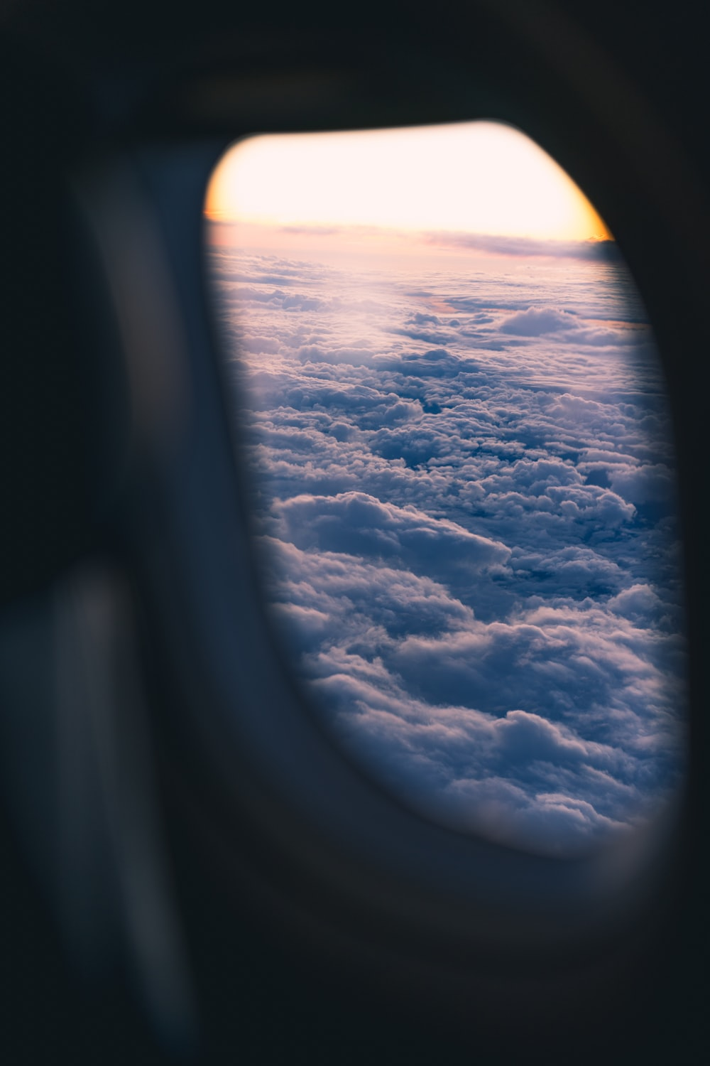 photo of clouds from airplane's window