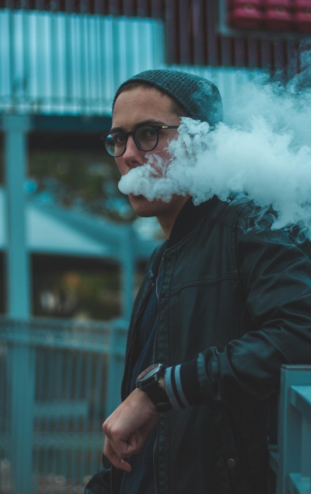 man vaping smoke