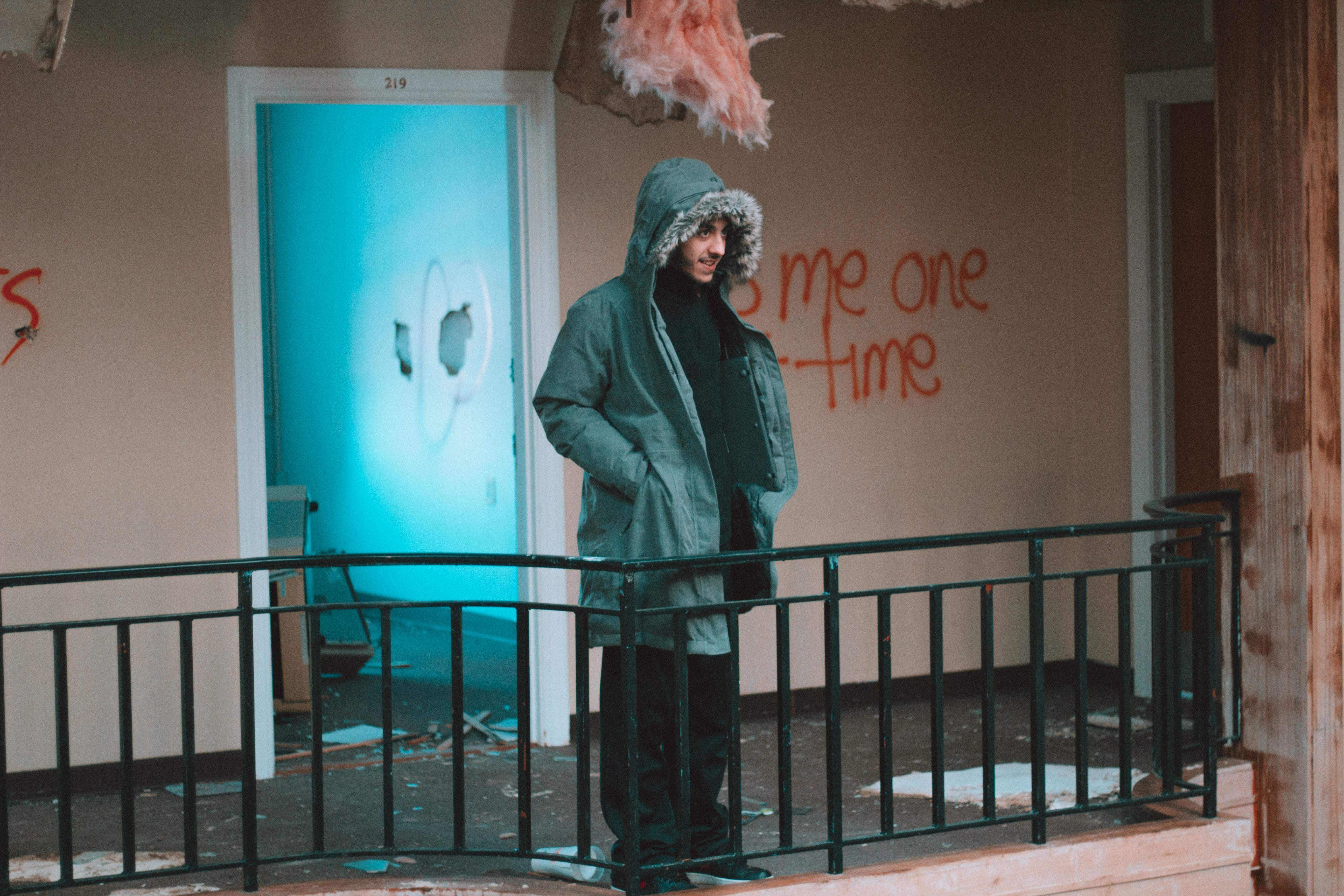 man standing near door