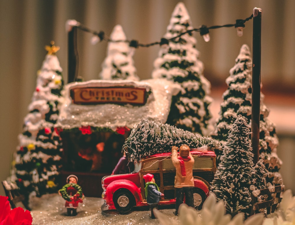 pine cone on top of red vehicle Christmas table decor