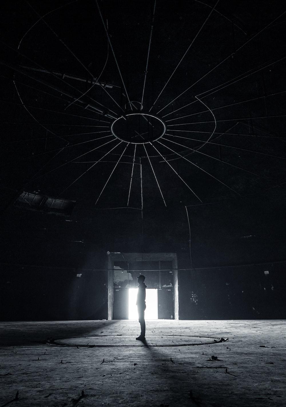 man standing inside dark building