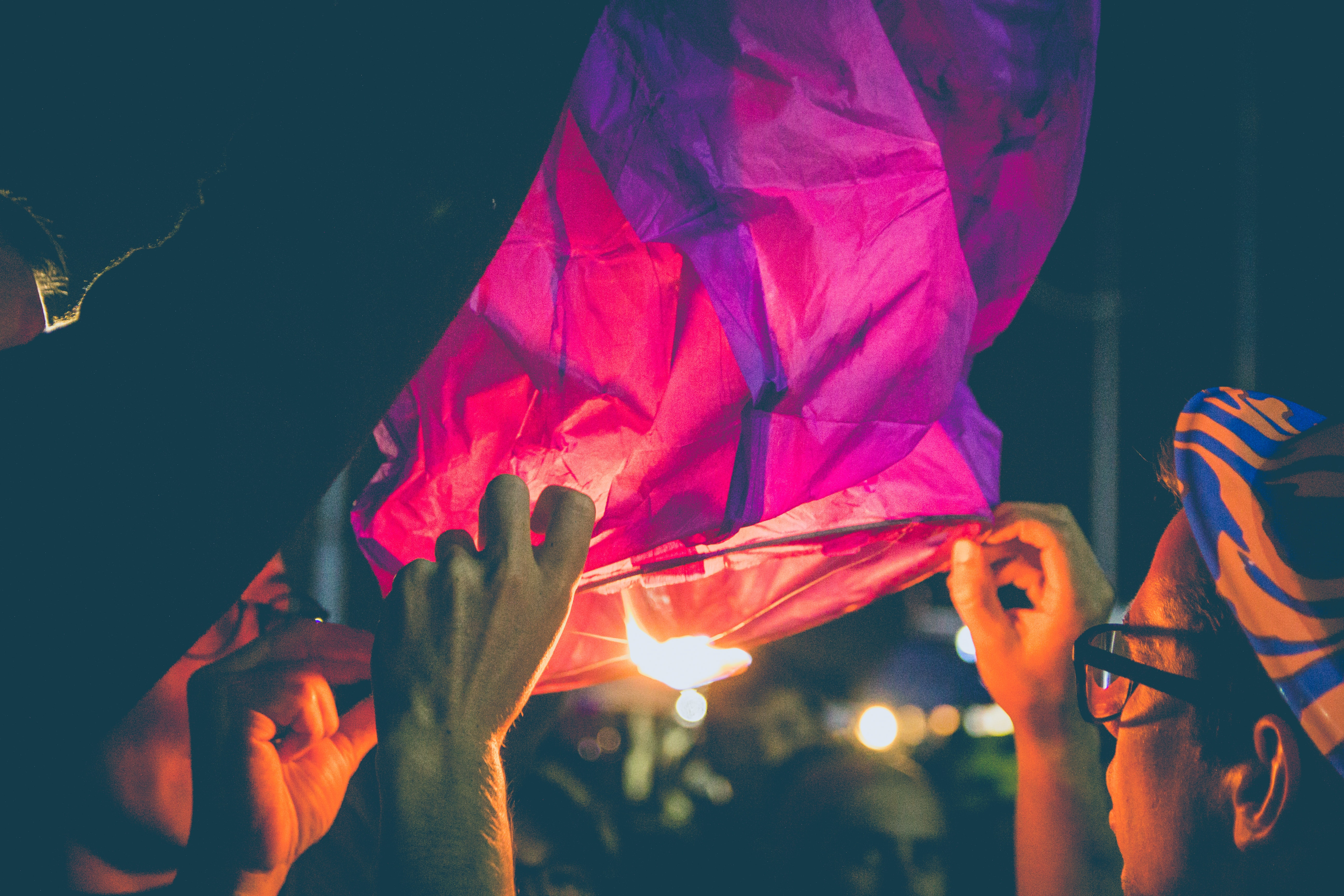 person's hand holding paper lantern