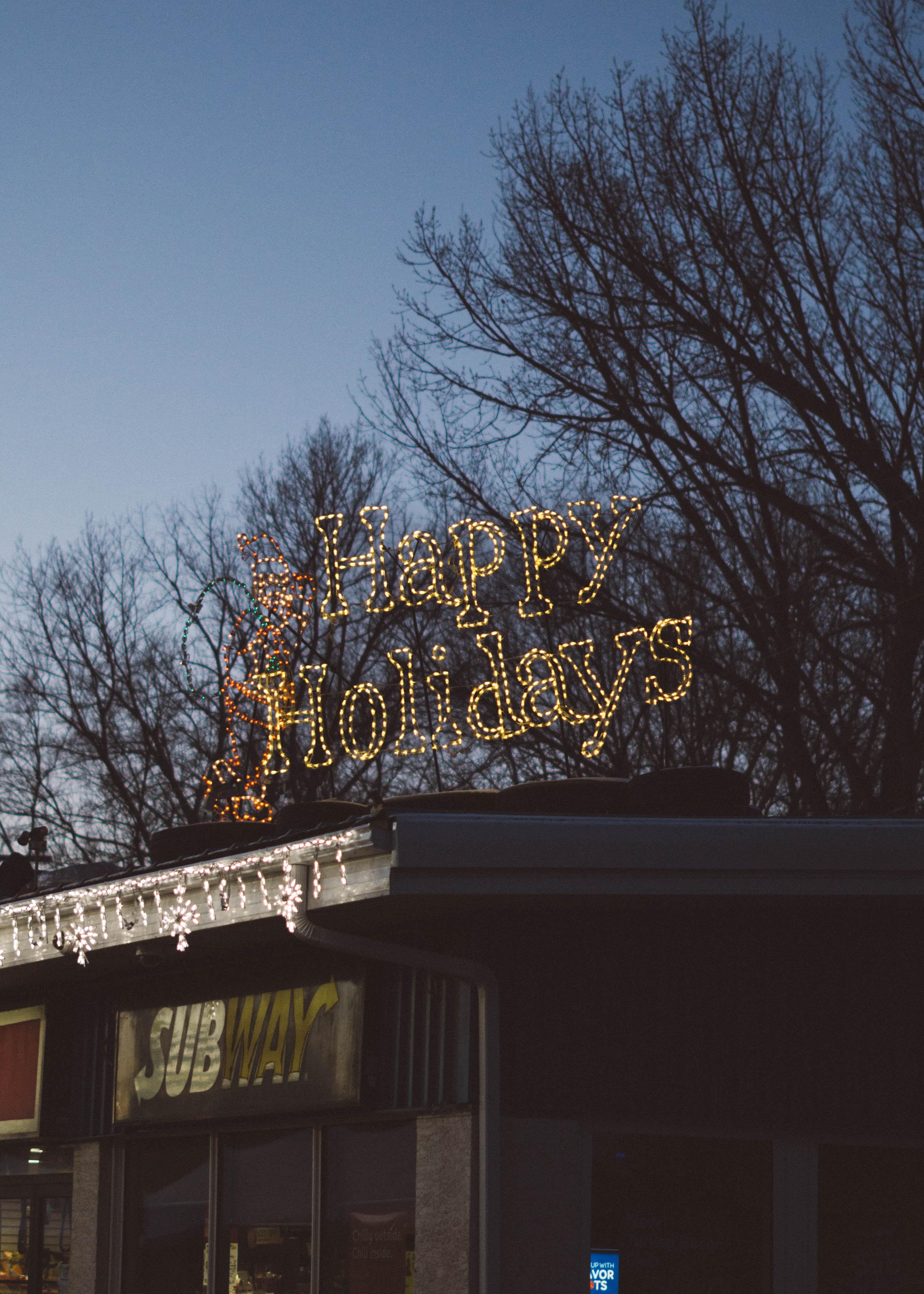 Happy Holidays LED signage during daytime